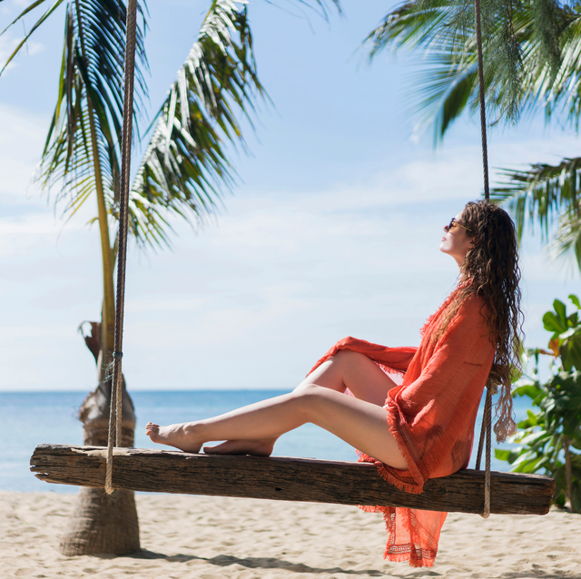 woman in coverup relaxing at the beach