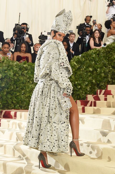 rihanna slays in pope inspired dress and hat at the 2018 met gala