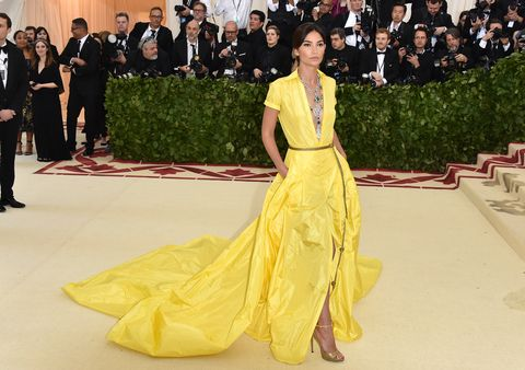 Red carpet, Yellow, Fashion, Dress, Clothing, Carpet, Gown, Haute couture, Fashion model, Flooring,