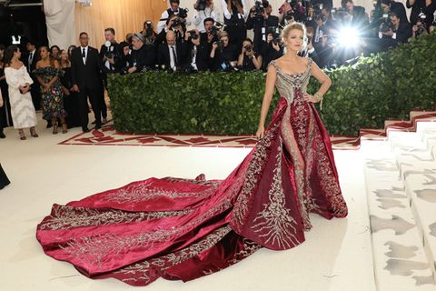 Dress, Red carpet, Clothing, Formal wear, Gown, Red, Fashion, Carpet, Beauty, Haute couture,