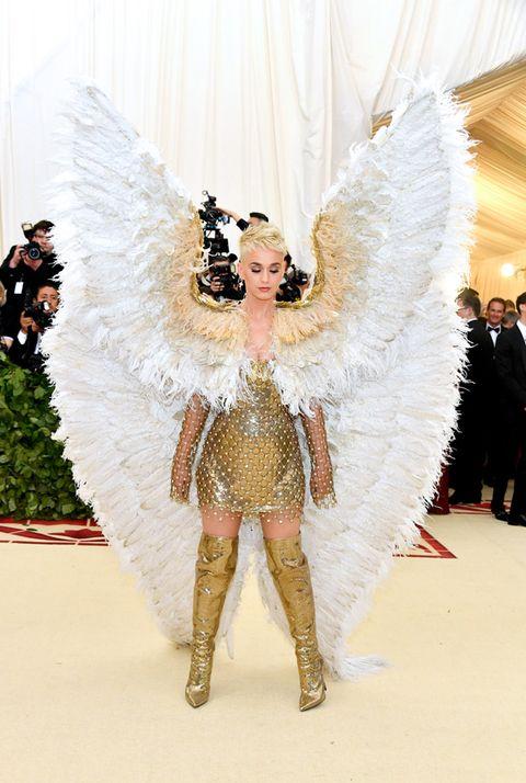 White, Wing, Feather, Fashion, Angel, Haute couture, Fashion show, Event, Supernatural creature, Fashion design,