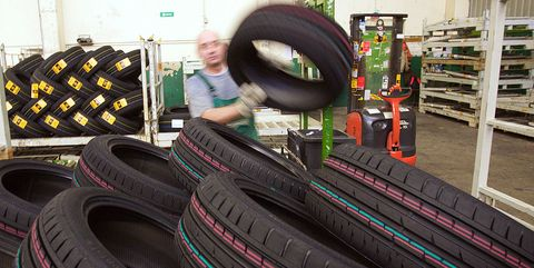 an employee stacks tires at the continental ag factory in aachen, germany, on wednesday, jan 6, 2010 continental ag, europes second largest auto parts maker, intends to raise 11 billion euros $16 billion in a stock sale to help refinance debt after receiving approval from its supervisory board photographer wolfgang von brauchitschbloomberg via getty images