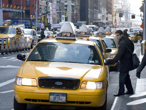 Land vehicle, Vehicle, Car, Taxi, Motor vehicle, Yellow, Ford crown victoria, Sedan, Metropolitan area, Mid-size car,