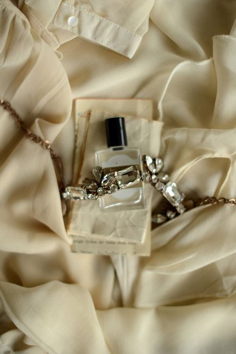 Perfume bottle and a necklace