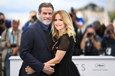 topshot   us actor john travolta l and his wife us actress kelly preston pose on may 15, 2018 during a photocall for the film gotti at the 71st edition of the cannes film festival in cannes, southern france photo by anne christine poujoulat  afp        photo credit should read anne christine poujoulatafp via getty images