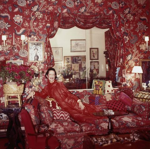 """fashion editor at harper's bazaar, editor in chief at vogue and special consultant to the metropolitan museum of art, diana vreeland, in her red billy baldwin designed """"garden in hell"""" living room, wearing a red lounging ensemble, 1979 photo by horst p horstconde nast via getty images"""