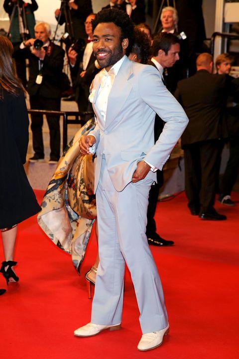 Red carpet, Carpet, Flooring, Premiere, Event, Fashion, Suit, Footwear, Dress, Leg,