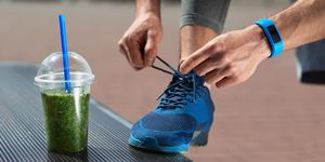 Nutrition. Male Legs With Healthy Detox Drink At Outdoor Workout
