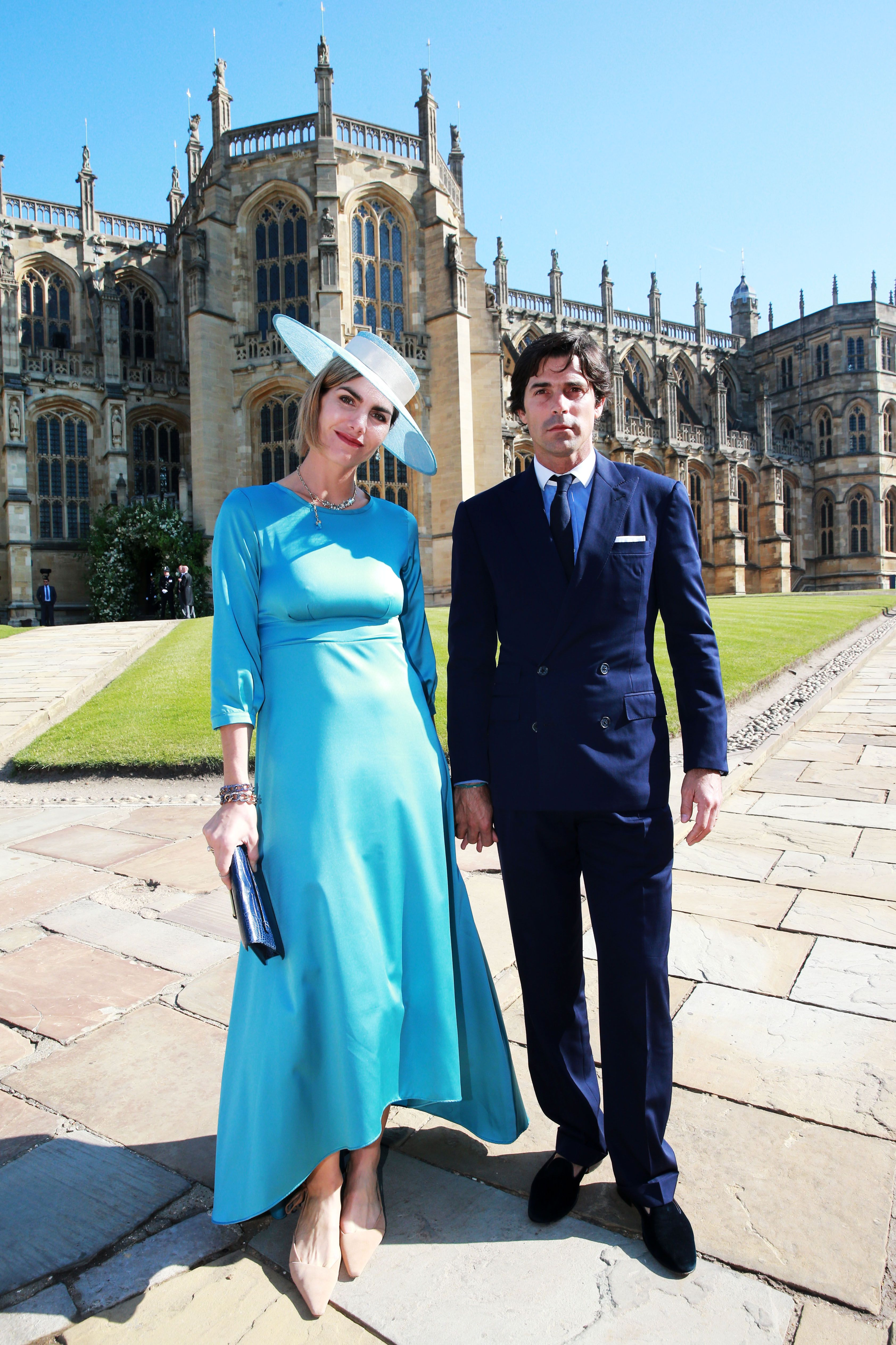 Figueras and Prince Harry are longtime friends—they met playing polo together. Blaquier is wearing a light blue Acheval Pampa dress with a matching hat.
