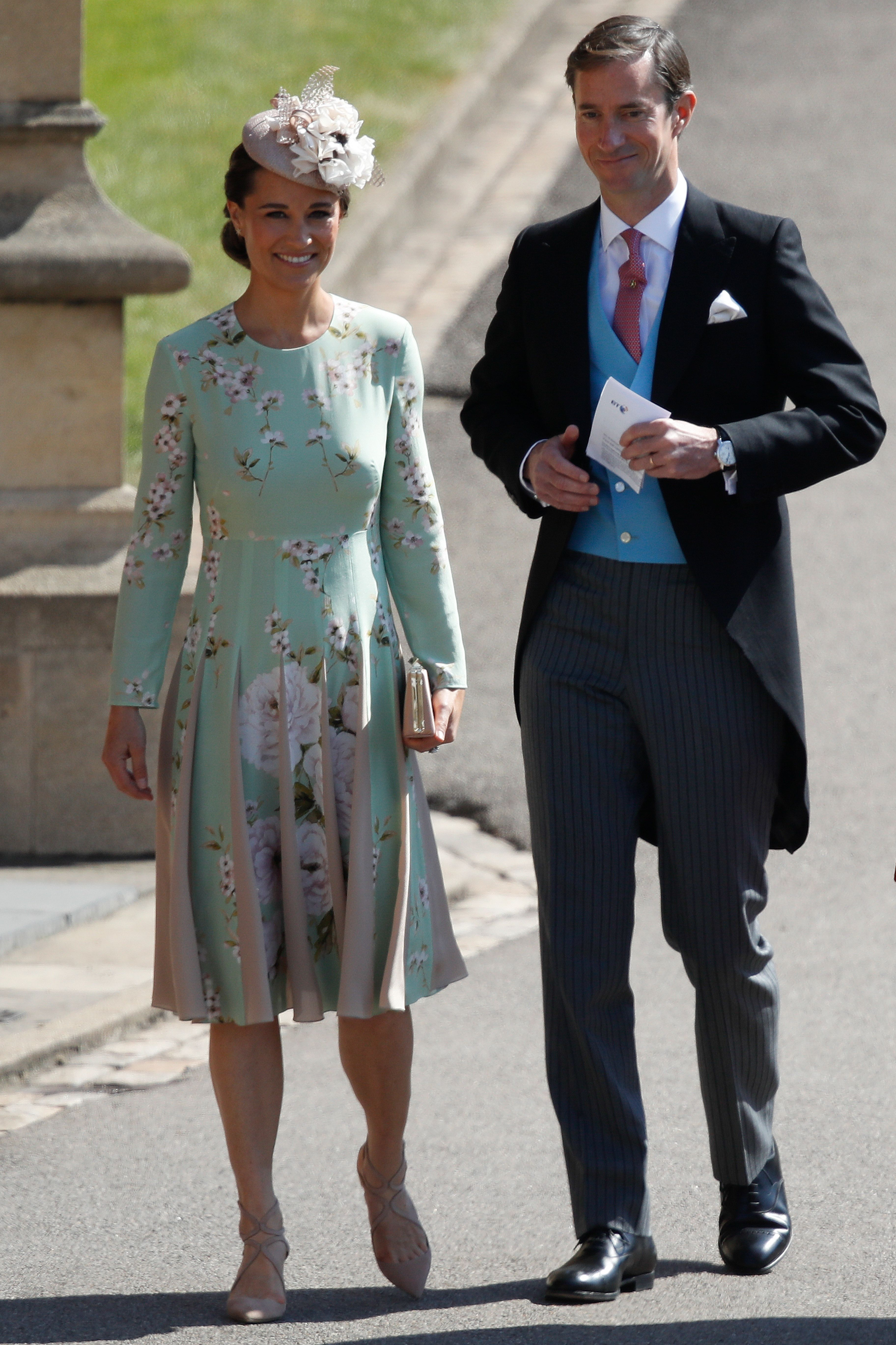 Kate Middleton's sister, who is reportedly pregnant , arrives in a mint green floral dress and nude sandals. Her husband James Spencer wears a morning suit.