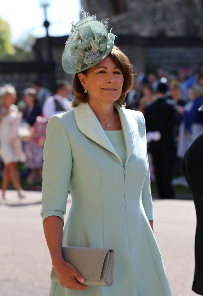 Kate Middleton's mother arrives in a pale green dress.