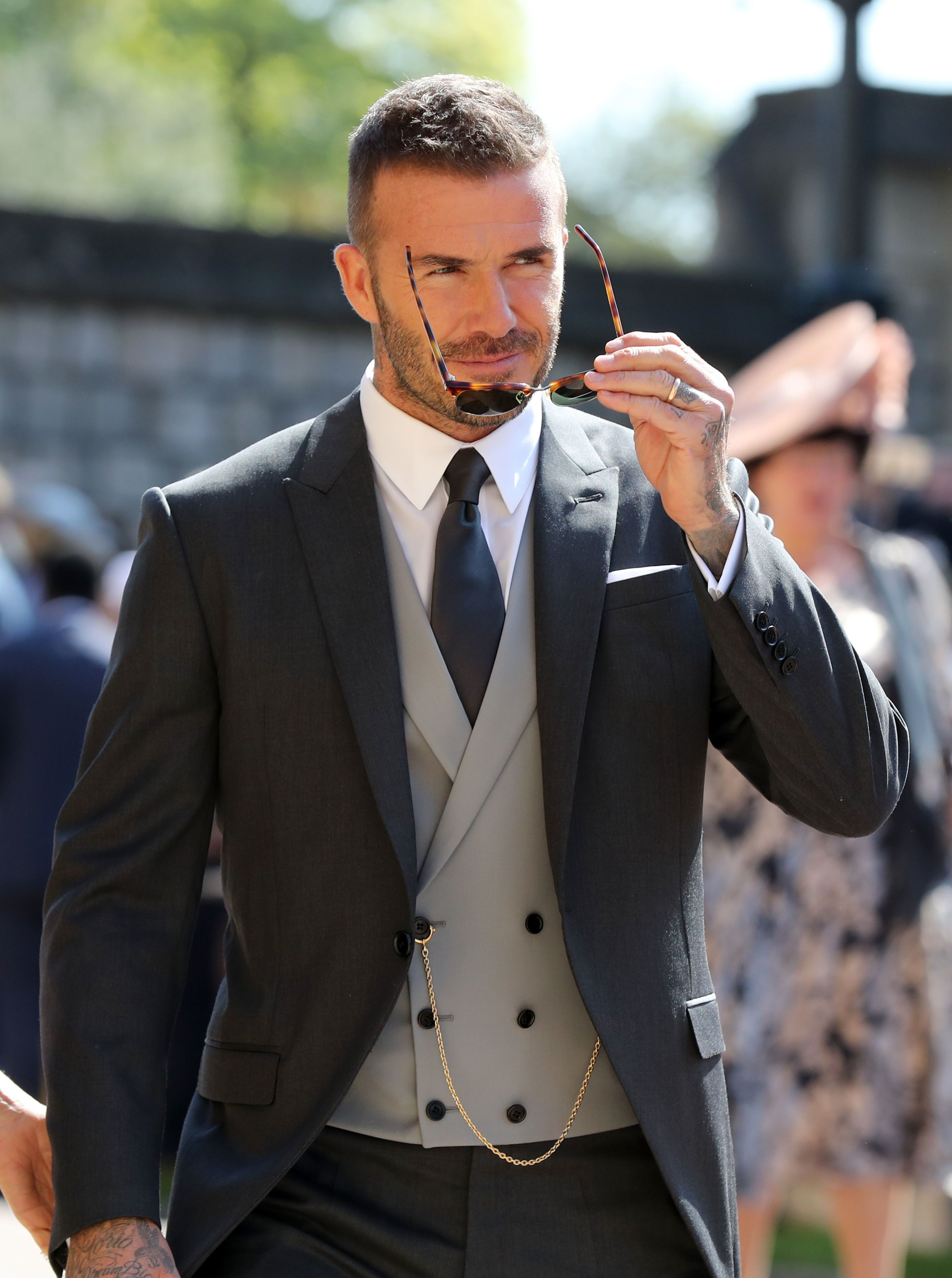 The former soccer player arrived wearing a charcoal grey wool twill morning coat and pants, a double-breasted waistcoat, a cotton poplin shirt, a grey silk satin tie and matching pocket square. The entire look was designed by Kim Jones for Dior Homme.