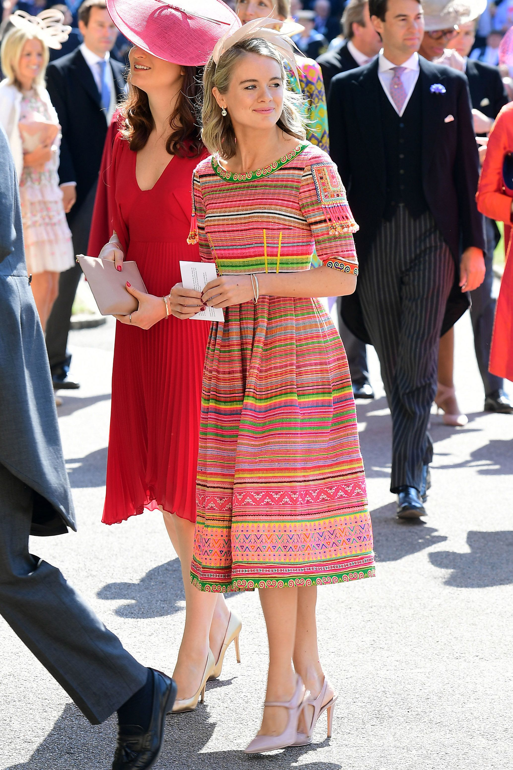 Prince Harry's ex-girlfriend is dressed in a bright colored striped tea-length dress. MORE : A Look Back at Prince Harry's Former Girlfriends