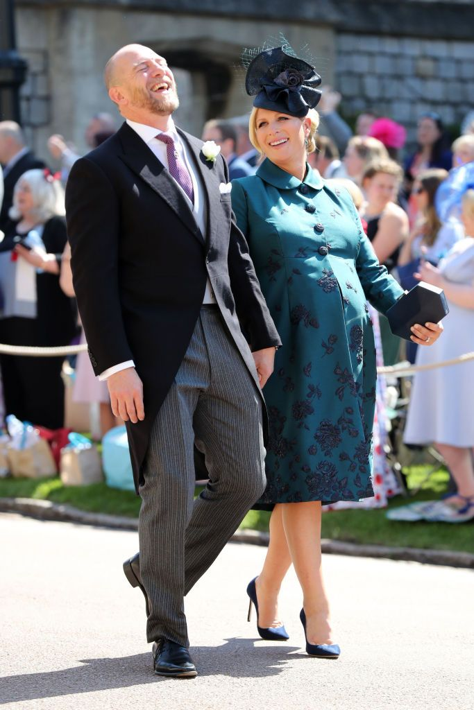 The former rugby player wore a suit with striped pants and a colorful tie. Zara, who is eight months pregnant, wore an embellished green frock coat, a black fascinator, and black pumps.