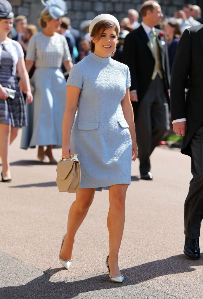 Princess Eugenie wears a light blue bespoke mini dress by Gainsbourg , a white pillbox hat, and Versace pumps.