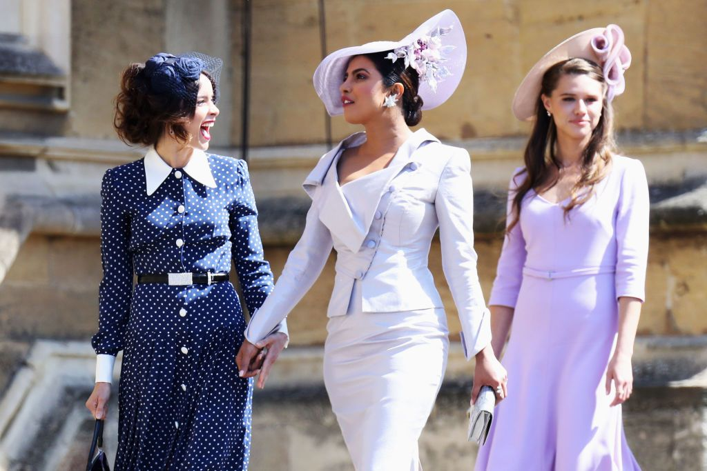 Two of Meghan's close friends from Hollywood both showed up with elegant toppers.