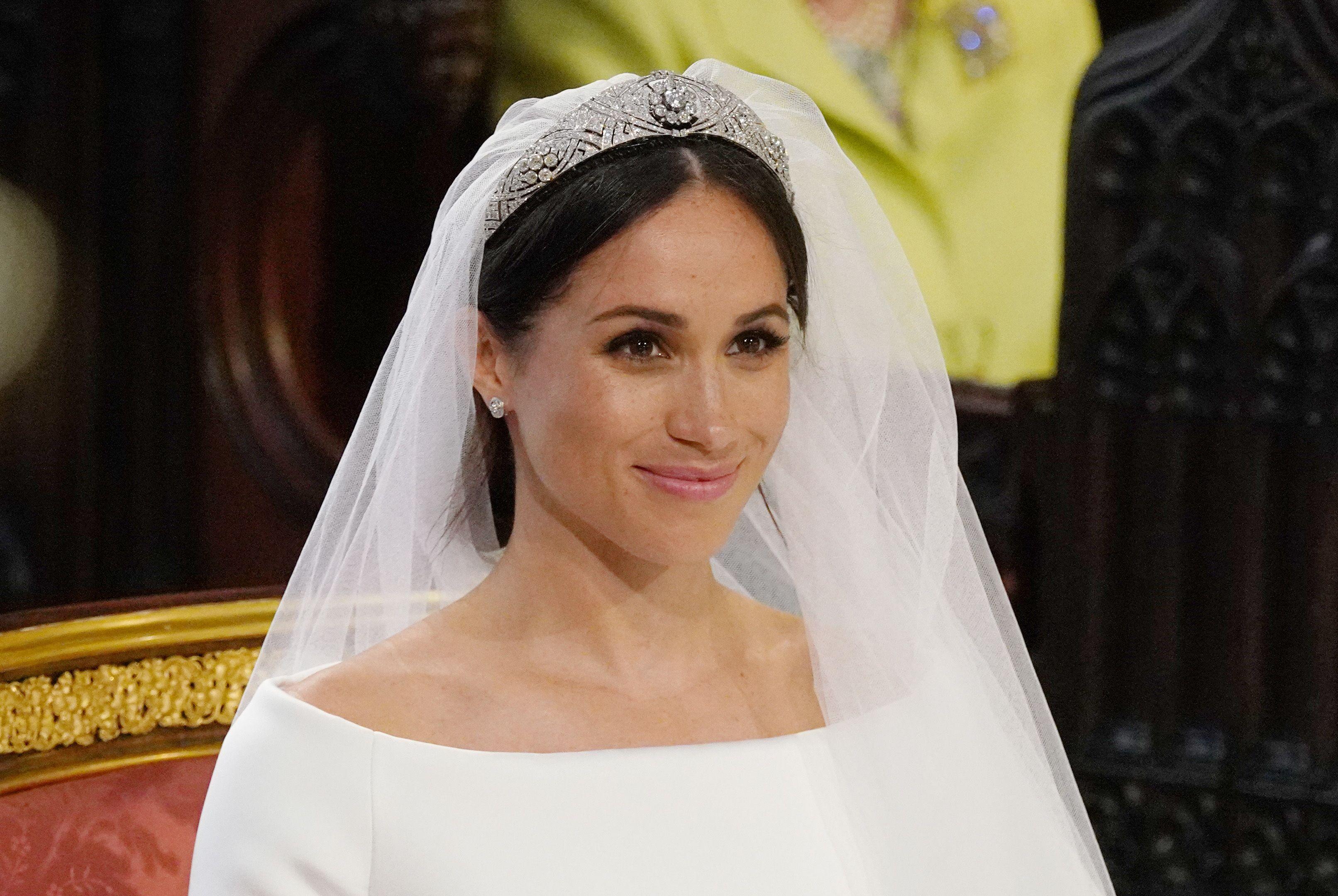 the queen found meghan markle s wedding dress questionable the queen found meghan markle s wedding