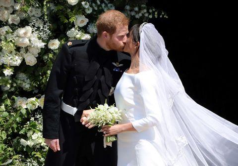 Bride, Wedding dress, Veil, Bridal veil, White, Gown, Bridal accessory, Marriage, Facial expression, Bridal clothing,