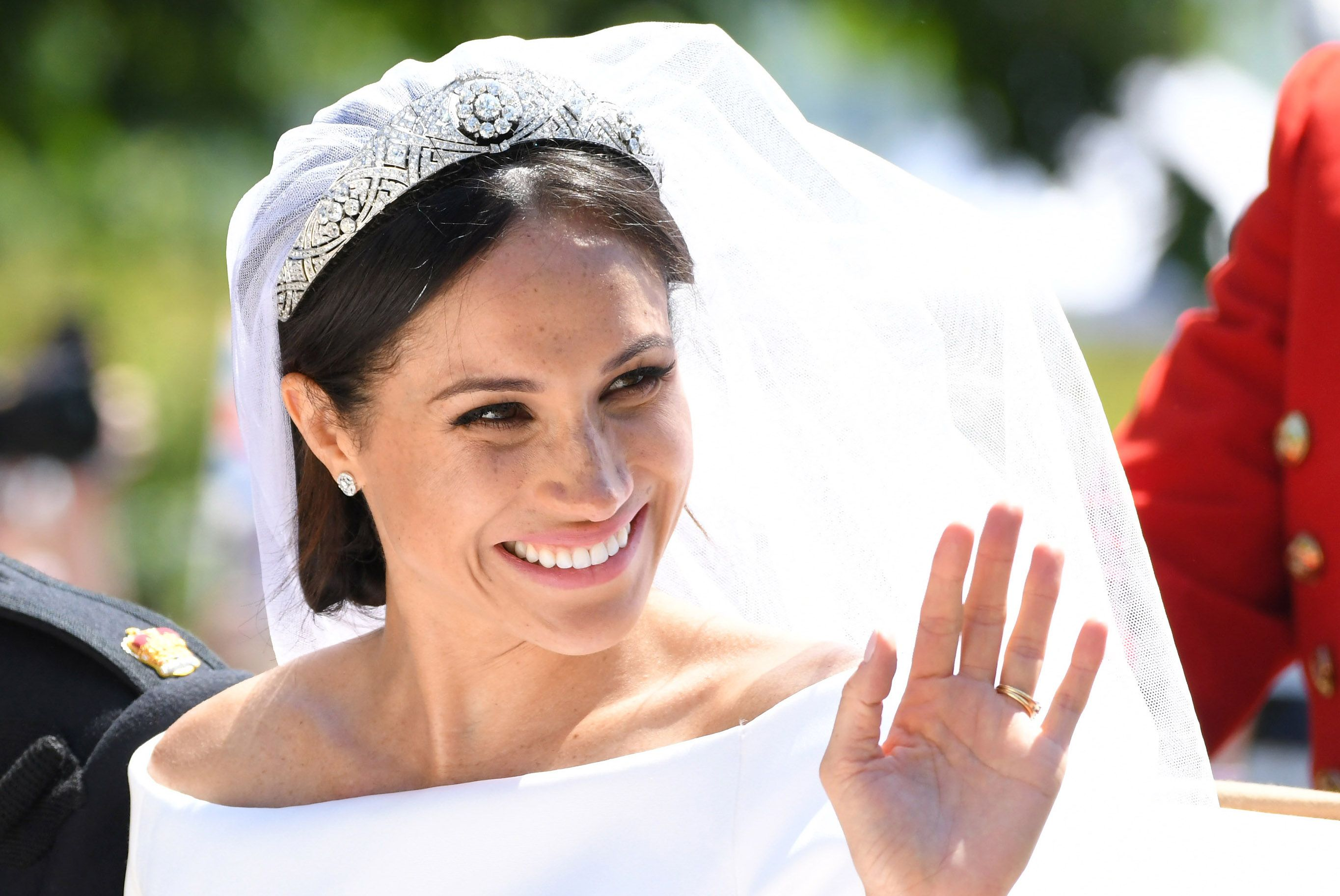 There was a lot of speculation going into the royal wedding about which tiara the new Duchess of Sussex would don for her big day. Ultimately, the actress borrowed a diamond and platinum bandeau setting from the Queen's collection which also has a special connection for Her Majesty—it belonged to Queen Mary, Elizabeth II's grandmother and was officially bequeathed to the Queen upon Mary's death.
