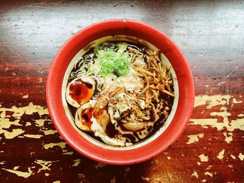 Bowl with ramen soup, directly above view