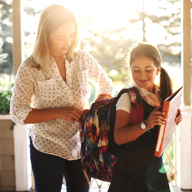 2f0a8947d76389 Mother zipping daughters backpack while standing in porch. Getty. There's  the shopping list the school sends you ...