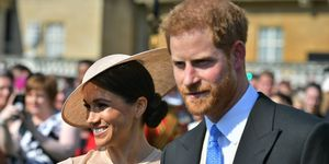 Meghan Markle and Prince Harry look as loved up as ever at their first Royal engagement