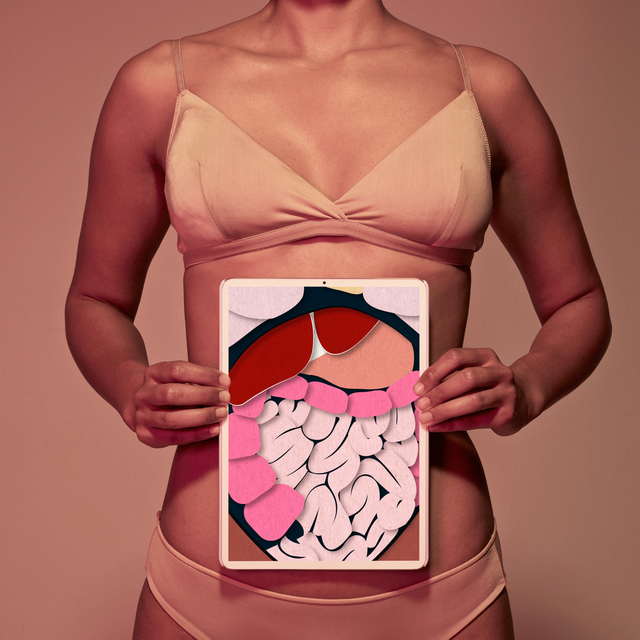 woman holding up gi system art on stomach