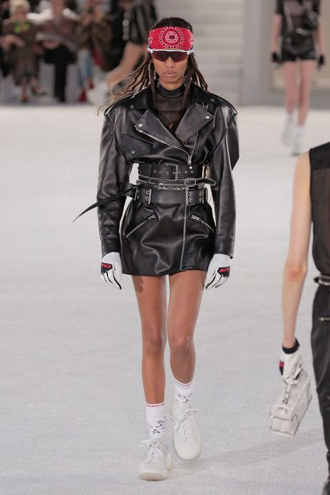 Fashion, Fashion model, Fashion show, Runway, Clothing, Street fashion, Jacket, Human, Footwear, Leather jacket,