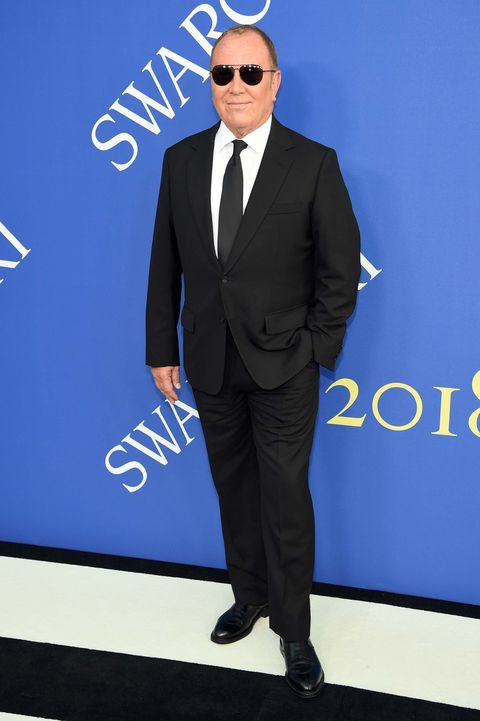 Suit, Formal wear, Electric blue, Cobalt blue, Tuxedo, White-collar worker, Eyewear, Outerwear, Pantsuit, Blazer,