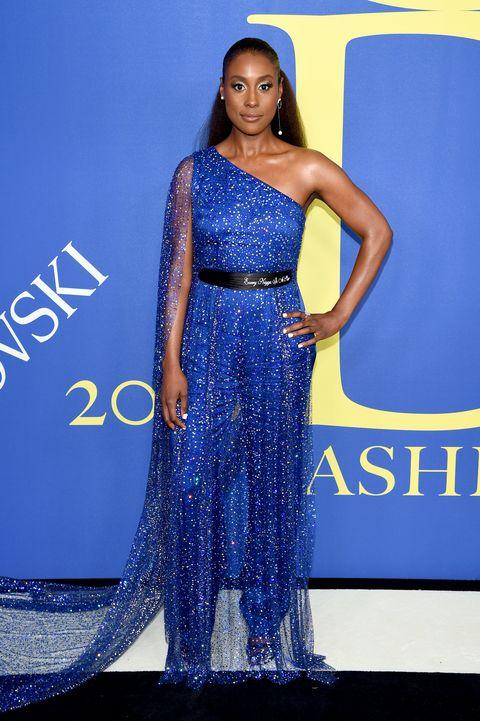 Cobalt blue, Clothing, Dress, Shoulder, Fashion model, Electric blue, Blue, Gown, Fashion, Joint,