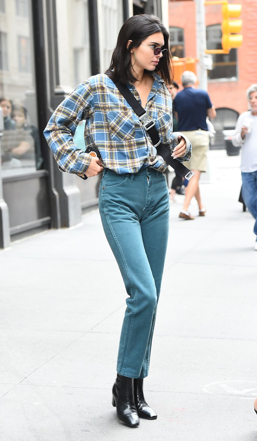 June 5, 2018 Kendall left the Broken Coconut in New York City in a plaid button-down shirt and teal-colored jeans.