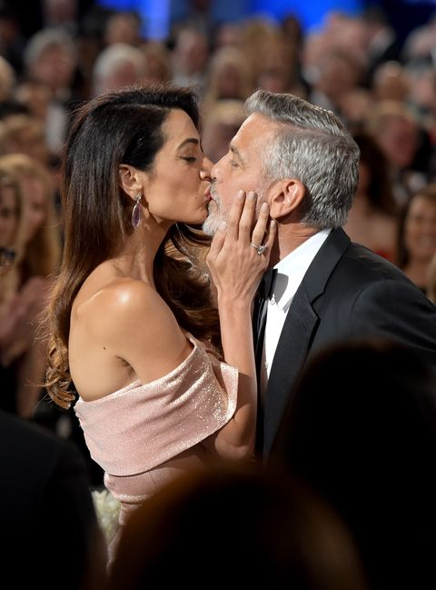 Photograph, Facial expression, Event, Interaction, Formal wear, Gesture, Suit, Kiss, Romance, Long hair,