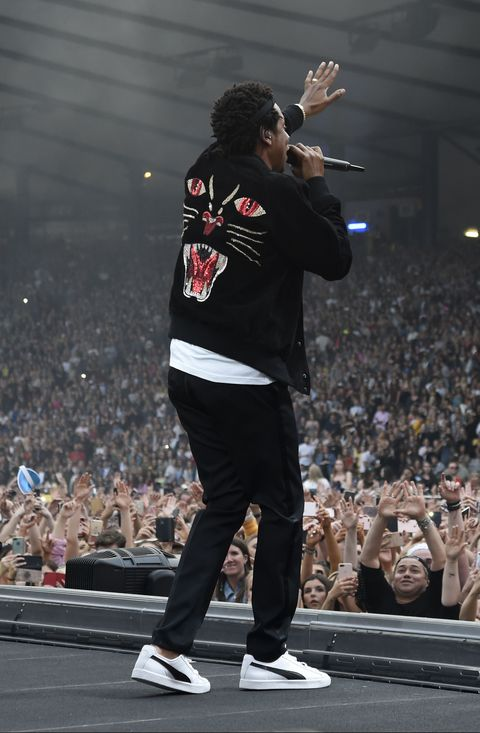 056df8e4d95 Jay-Z wearing Puma sneakers onstage during the On the Run II tour on June 9.