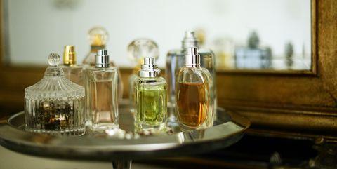 Perfume, Glass bottle, Bottle, Alcohol, Liqueur, Drink, Glass, Room, Distilled beverage, Cosmetics,