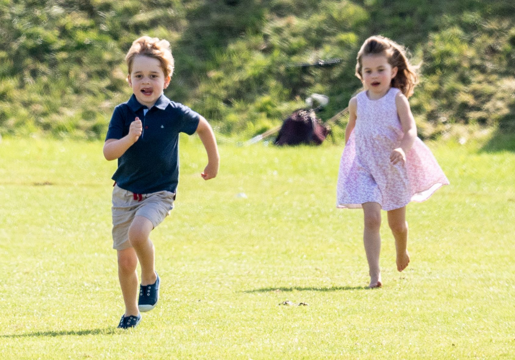 Prince George and Princess Charlotte play at a polo match in June