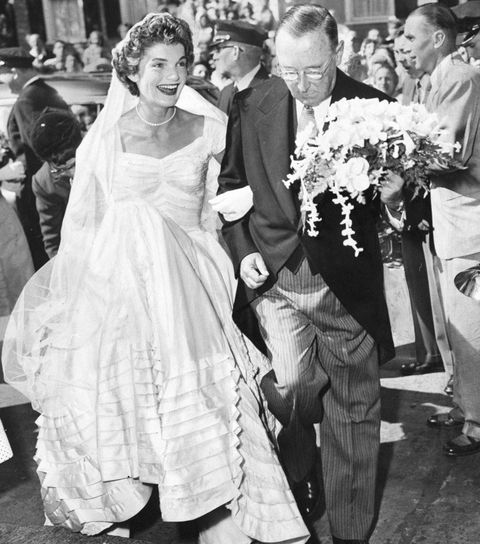A smiling Jacqueline Bouvier arrives at St. Mary's Church in