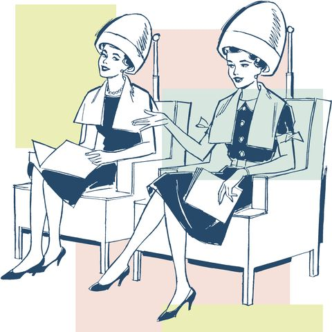 Two Women Under Hairdryers at a Salon