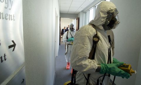 FIrefighters in Hazmat gear respond to a suspected white powder incident in 2001.