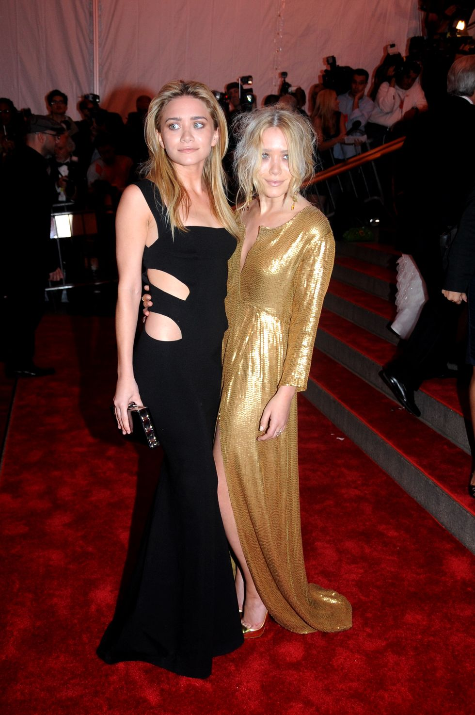 May 05, 2008 For their fourth Met Gala appearance, the twins both wore dresses by Diane von Furstenberg. Ashley opted for a simple black gown with cut-outs, but Mary-Kate stood out in shimmering gold.