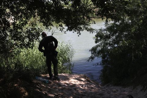 AU.S. border patrol agent monitors the Rio Grande.