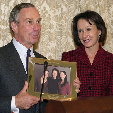 With his former wife, Susan Brown, smiling at his side, Mayo