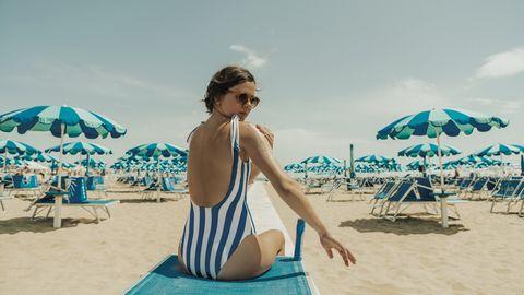 People on beach, Vacation, Sun tanning, Umbrella, Summer, Beach, Turquoise, Sand, Travel, Fun,