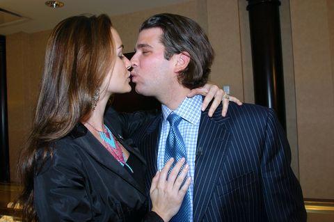 Interaction, Suit, Event, Formal wear, Fun, Kiss, Gesture, Outerwear, Conversation, Tie,