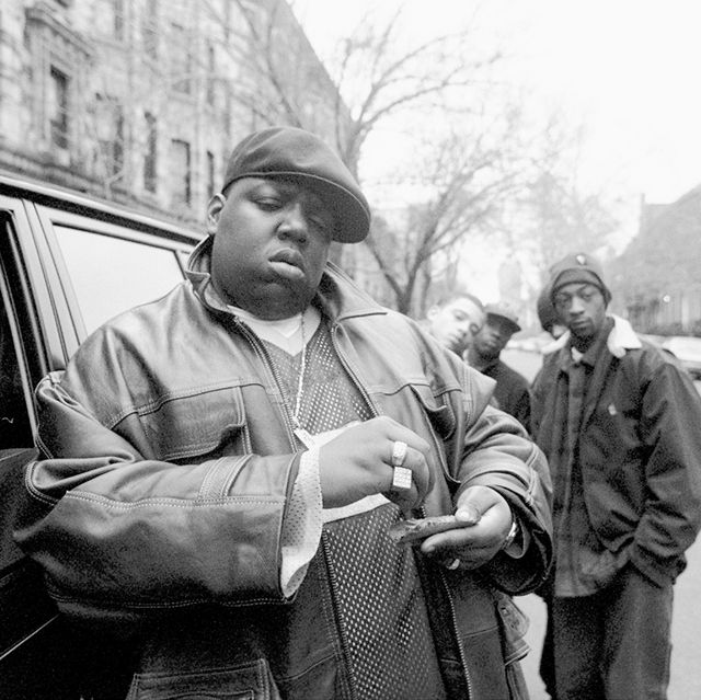 american rapper notorious big, aka biggie smalls, aka chris wallace 1972   1997, rolls a cigar outside his mother's house in brooklyn, new york, 18th january 1995  photo by clarence davisny daily news archive via getty images