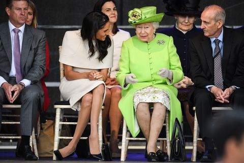 chester, england   june 14  queen elizabeth ii sits and laughs with meghan, duchess of sussex during a ceremony to open the new mersey gateway bridge on june 14, 2018 in the town of widnes in halton, cheshire, england meghan markle married prince harry last month to become the duchess of sussex and this is her first engagement with the queen during the visit the pair will open a road bridge in widnes and visit the storyhouse and town hall in chester  photo by jeff j mitchellgetty images