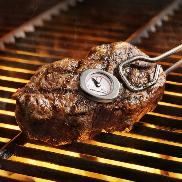 meat on grill with thermometer