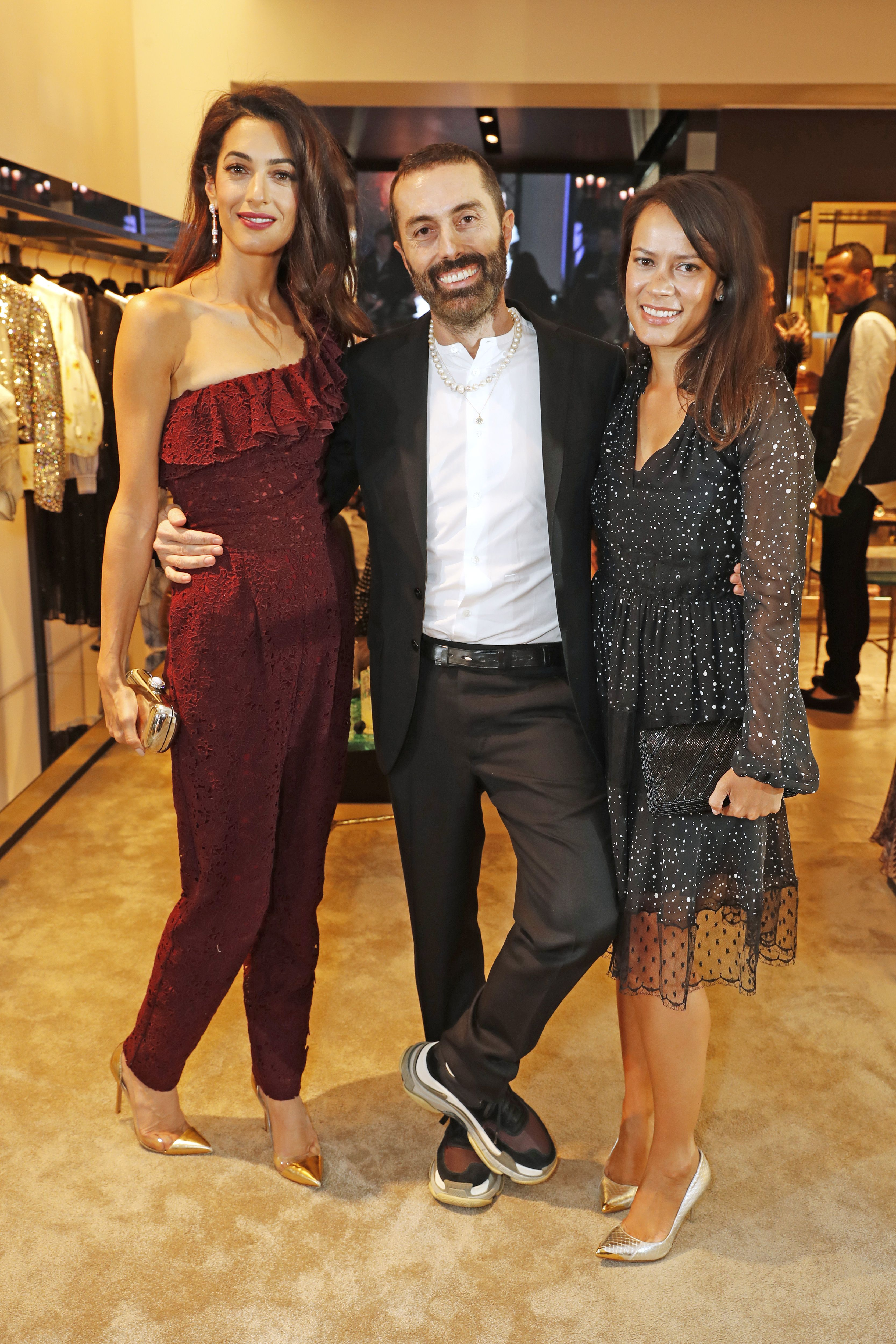 June 14, 2018 In a Giambattista Valli jumpsuit with designer Giambattista Valli and Philippa Webb at the brand's London store opening on Sloane Street.