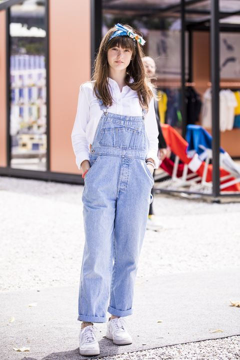 florence, italy   june 14   a guest, wearing a denim overall and white shirt, is seen during the 94th pitti immagine uomo at fortezza da basso on june 14, 2018 in florence, italy photo by claudio laveniagetty images