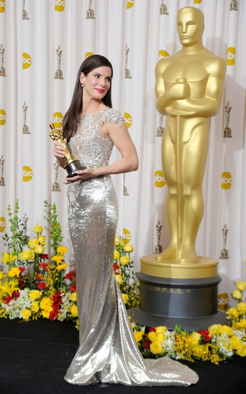 Yellow, Dress, Clothing, Gown, Fashion, Shoulder, Fashion model, Haute couture, Hairstyle, Statue,