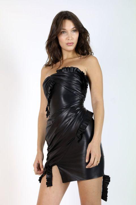 Clothing, Fashion model, Dress, Black, Cocktail dress, Shoulder, Model, Photo shoot, Fashion, Latex clothing,